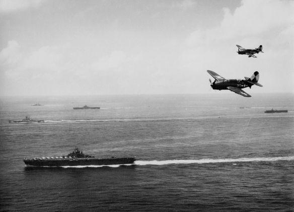 1280px-USS_Essex_(CV-9)_with_TG_38_3_off_Okinawa_1945