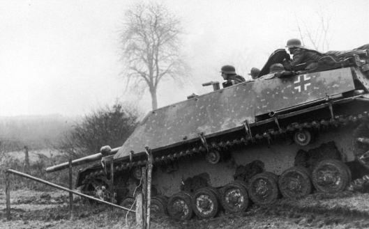"""Subject: German soldiers riding in tank during the """"Battle of the Bulge"""" Belgium 1944. Photographer- U.S. Army Public Domain Merlin-1141002"""