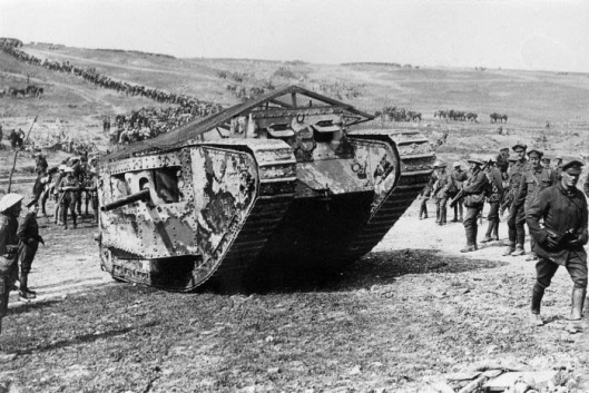 """IWM-Q 5574 THE BATTLE OF THE SOMME 1 JULY - 18 NOVEMBER 1916 MINISTRY OF INFORMATION FIRST WORLD WAR OFFICIAL COLLECTION PRODUCTION DATE: 15 September 1916 MAKER: Brooke, J W (Lt) DESCRIPTION: The Battle of Flers Courcelette 15 - 22 September: A 'C' Company Mark I (C19 Clan Leslie) in Chimpanzee Valley preparing for action. Haig had 49 tanks available but due to mechanical problems only 18 went forward in small groups with the advance. Other Description: A 'C' Company Mark I tank (C. 19 """"Clan Leslie"""") Chimpanzee Valley, 15 September 1916. Tanks first went into action on this day."""