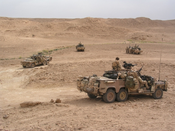 AN SAS patrol occupies a low-lying position to remain undetected by passing Iraqi's. Patrols observing enemy movements could quickly call on the support of these vehicles if required.