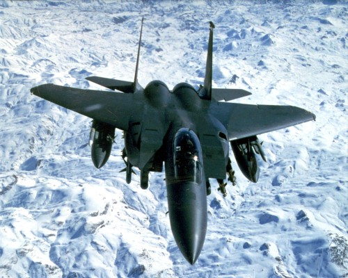 990218-F-0000L-001 A U.S. Air Force F-15E Eagle flies above snow covered mountains during a routine patrol over Northern Iraq on Feb. 18, 1999, in support of Operation Northern Watch.  Northern Watch is the coalition enforcement of the no-fly-zone over Northern Iraq.  The Eagle is deployed from the 494th Expeditionary Fighter Squadron, RAF Lakenheath, United Kingdom.  DoD photo by Capt. Patricia Lang, U.S. Air Force.  (Released)