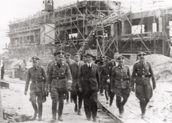 Reichsfuehrer SS Heinrich Himmler tours the Monowitz-Buna building site in the company of SS officers and IG Farben engineers
