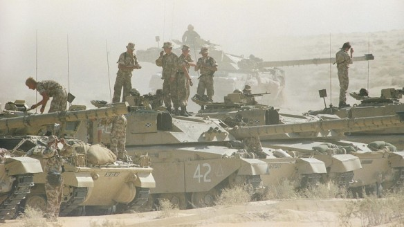Tank crews with the British 7th Armoured Brigade stand atop their Challenger tanks after a simulated battle in the dusty eastern Saudi Arabian desert, Saturday, Dec. 1, 1990 in Saudi Arabia. (AP Photo/Diether Endlicher)