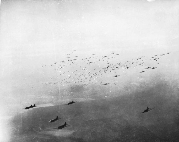 c-47_transport_planes_release_hundreds_of_paratroops