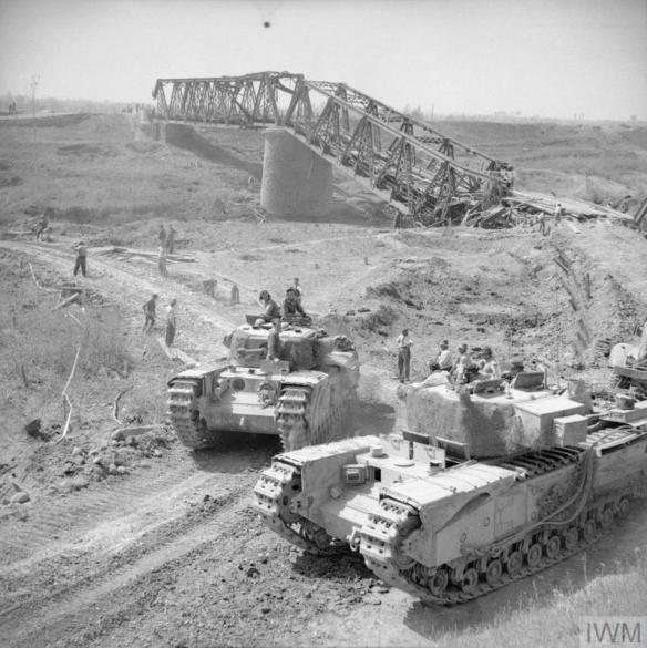 THE BRITISH ARMY IN ITALY 1945 (NA 24306) Churchill tanks of 21st Army Tank Brigade cross the River Reno close to a destroyed railway bridge near Bastia, 18 April 1945. Copyright: © IWM. Original Source: http://www.iwm.org.uk/collections/item/object/205204783