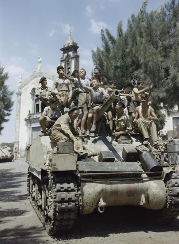 local_children_crowd_aboard_a_sherman_mk_iii_tank_of_the_county_of_london_yeomanry_in_the_village_of_milo_near_catania_in_sicily_august_1943-_tr1244